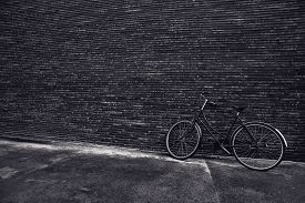 foto of monochromatic  - Classic vintage hipster bicycle leaning against the street wall black and white monochromatic instagram like retro toned image for cycling culture and healthy lifestyle in urban environment with copy space - JPG