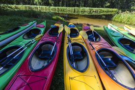 picture of kayak  - Colorful fiberglass kayaks tethered to a dock as seen from above - JPG