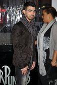 LOS ANGELES - MAR 23:  Joe Jonas arrives at the