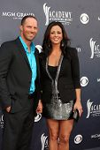LAS VEGAS - APR 3:  Sara Evans & Husband arrive at the Academy of Country Music Awards 2011 at MGM Grand Garden Arena on April 3, 2010 in Las Vegas, NV.