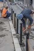Workers Installing Posts poster