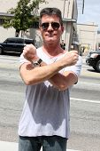 LOS ANGELES - MAY 8:  Simon Cowell, one of the talent judges,  arriving at the