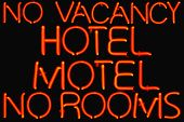Red neon sign for accommodation.