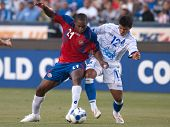 CARSON, CA. - JULY 3: Concacaf Gold Cup soccer match, Costa Rica vs. El Salvador at the Home Depot center in Carson. Froylan Ledezma and Manuel Salazar fighting for the ball on July 3, 2009.