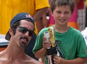 HERMOSA BEACH, CA. - AUGUST 9: Todd Rogers and his son Nate Rogers after the mens final of the AVP H