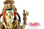 Ganesh statue and a candle