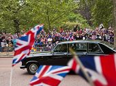 LONDON, UK - APRIL 29: An old Jaguar on the Mall at Prince William and Kate Middleton wedding, April 29, 2011 in London, United Kingdom