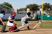 MESA, AZ - NOV 20: Kevin Frandsen of  the Scottsdale Scorpions hits with Mesa Solar Sox catcher Lou Marson behind the plate, in the Arizona Fall League game on November 20, 2008 in Mesa, Arizona
