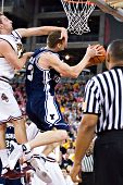 GLENDALE, AZ - DECEMBER 20: Brigham Young center Gavin MacGregor #53 is fouled by Rihards Kuksiks #3