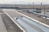CHANDLER, AZ - OCTOBER 2: Hot rod cars compete in the NHRA Pacific Division drag racing championship