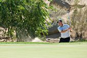SCOTTSDALE, AZ - OCTOBER 21: Tom Lehman hits out of a sand trap in the Frys.com Open PGA golf tourna