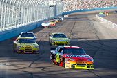 AVONDALE, AZ - APRIL 10: Jeff Gordon (#24) leads a group of cars into turn one at the Subway Fresh F