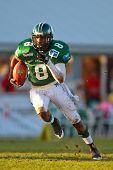 KORNEUBURG, AUSTRIA - APR 4: Austrian Football League:  RB Marques Binns (#8, Dragons) and his team lose 35:52 to Tirol Raiders on April 4, 2009 in Korneuburg, Austria.