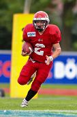 WOLFSBERG, AUSTRIA - AUGUST 18 American Football B-EC: RB Dan Klatoft B?hm (#2, Denmark) and his team lose 15:30 against Czech Republic on August 18, 2009 in Wolfsberg, Austria.