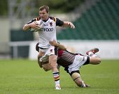 TWICKENHAM UK AUGUST 03, Lestyn Harris is tackled as he runs with the ball  Playing in the Engage Su