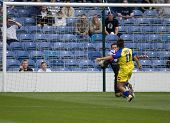 LONDON, UK AUGUST 2,Antimo Lunco attempts to lob Lee Camp at the pre-season friendly football match