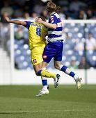 LONDON, UK AUGUST 2,Gareth Ainsworth and Mirco Gasparetto leap for the ball at the pre-season friend