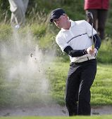 GLENEAGLES SCOTLAND AUGUST 28, Simon Dyson from England takes a bunker shot whilst competing in the Johnnie Walker Classic PGA European Tour golf tournament at Gleneagles Perthshire Scotland
