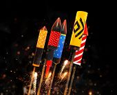 Group of fireworks rockets launching, isolated on black background. Concept of celebration and New Y poster
