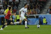 INNSBRUCK - JUNE 10: Konstantin Zyryanov of Russia (in white) & David Silva of Spain (in red)  durin