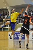 NAGYATAD, HUNGARY - APRIL 5: Gergely Kiss ready to score at Hungarian National Handball Championship
