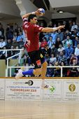 NAGYATAD, HUNGARY - FEBRUARY 5: Peter Gulyas (with the ball) in action at Hungarian Cup Handball mat