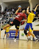 NAGYATAD, HUNGARY - FEBRUARY 5: Perez Carlos (L) makes a throw at Hungarian Cup Handball match (Nagy
