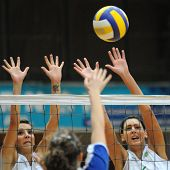 KAPOSVAR, HUNGARY - DECEMBER 17: Unidentified players blocks the ball at the Hungarian Extra League woman volleyball game between Kaposvar and Miskolc , December 17, 2008 in Kaposvar, Hungary.