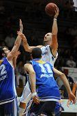 KAPOSVAR, HUNGARY - SEPTEMBER 4: Gergely David (in white) in action at a friendly basketball game Ka