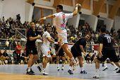 CSURGO, HUNGARY - OCTOBER 21: Zarko Sesum (with the ball) in action at Hungarian National Handball C
