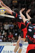 KAPOSVAR, HUNGARY - APRIL 24: Robert Koch (C) blocks the ball at a Hungarian National Championship F