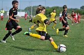KAPOSVAR, HUNGARY - JULY 19: Unidentified players in action at a VI. Youth Football Festival match E