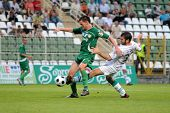 KAPOSVAR, HUNGARY - AUGUST 14: Pedro Sass (R) in action at a Hungarian National Championship soccer