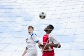 Male player playing soccer against sky poster