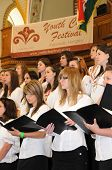 KAPOSVAR, HUNGARY - AUGUST 26: Members of the Kodaly Zoltan Grammar School Choir sing at the IV. Pan