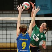 KAPOSVAR, HUNGARY - NOVEMBER 14: Rebeka Rak (L) blocks the ball at the Hungarian NB I. League woman