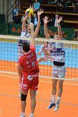 KAPOSVAR, HUNGARY - NOVEMBER 25: Krisztian Csoma (L) blocks the ball at the CEV Cup volleyball game