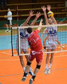 KAPOSVAR, HUNGARY - NOVEMBER 25: Krisztian Csoma (R) blocks the ball at the CEV Cup volleyball game