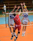 KAPOSVAR, HUNGARY - NOVEMBER 25: Krisztian Csoma (R) blocks the ball at the CEV Cup volleyball game