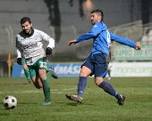 KAPOSVAR, HUNGARY - NOVEMBER 27: Pedro Sass (L) in action a Hungarian National Championship soccer g