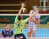 KAPOSVAR, HUNGARY - DECEMBER 8: Krisztian Csoma (in white) blocks the ball at the Challenge Cup voll