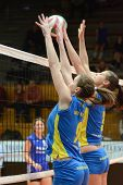 KAPOSVAR, HUNGARY - DECEMBER 19: Rebeka Rak (L) blocks the ball at the Hungarian NB I. League woman