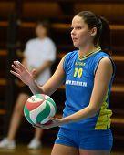 KAPOSVAR, HUNGARY - DECEMBER 19: Szandra Szombathelyi serves the ball at the Hungarian NB I. League