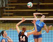 KAPOSVAR, HUNGARY - JANUARY 14: Zsofia Harmath (R) strikes the ball at the Hungarian NB I. League woman volleyball game Kaposvar vs Ujbuda, January 14, 2011 in Kaposvar, Hungary.