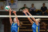 KAPOSVAR, HUNGARY - JANUARY 23: Rebeka Rak (L) blocks the ball at the Hungarian NB I. League woman v