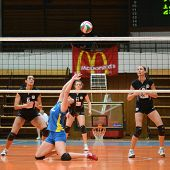 KAPOSVAR, HUNGARY - JANUARY 23: Marianna Palfy (in blue) posts the ball at the Hungarian NB I. Leagu
