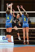 KAPOSVAR, HUNGARY - JANUARY 23: Zsofia Harmath (3) blocks the ball at the Hungarian NB I. League wom