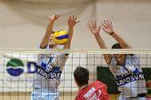 KAPOSVAR, HUNGARY - JANUARY 28: Krisztian Csoma (L) blocks the ball at a Middle European League voll