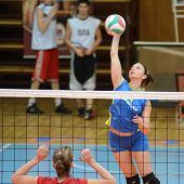 KAPOSVAR, HUNGARY - FEBRUARY 4: Barbara Balajcza (R) strikes the ball at the Hungarian NB I. League