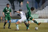 KAPOSVAR, HUNGARY - FEBRUARY 16: Pedro Sass Pedrazzi (C) in action at a Hungarian National Cup socce